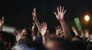 church_crowd_hands_raised